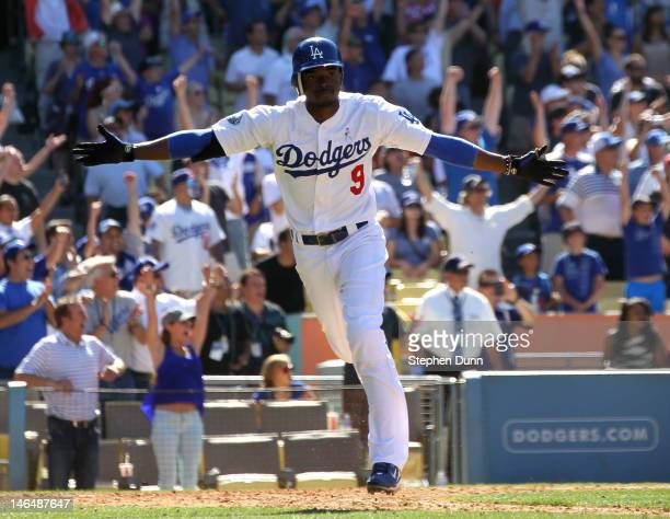 Dee Gordon of the Los Angeles Dodgers celebrates as he runs to first after hitting a game winning walk off single in the tenth inning against the...