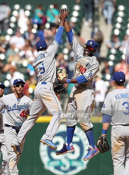 Dee Gordon of the Los Angeles Dodgers celebrates with Tony Gwynn Jr #10 after defeating the Seattle Mariners 82 at Safeco Field on June 10 2012 in...