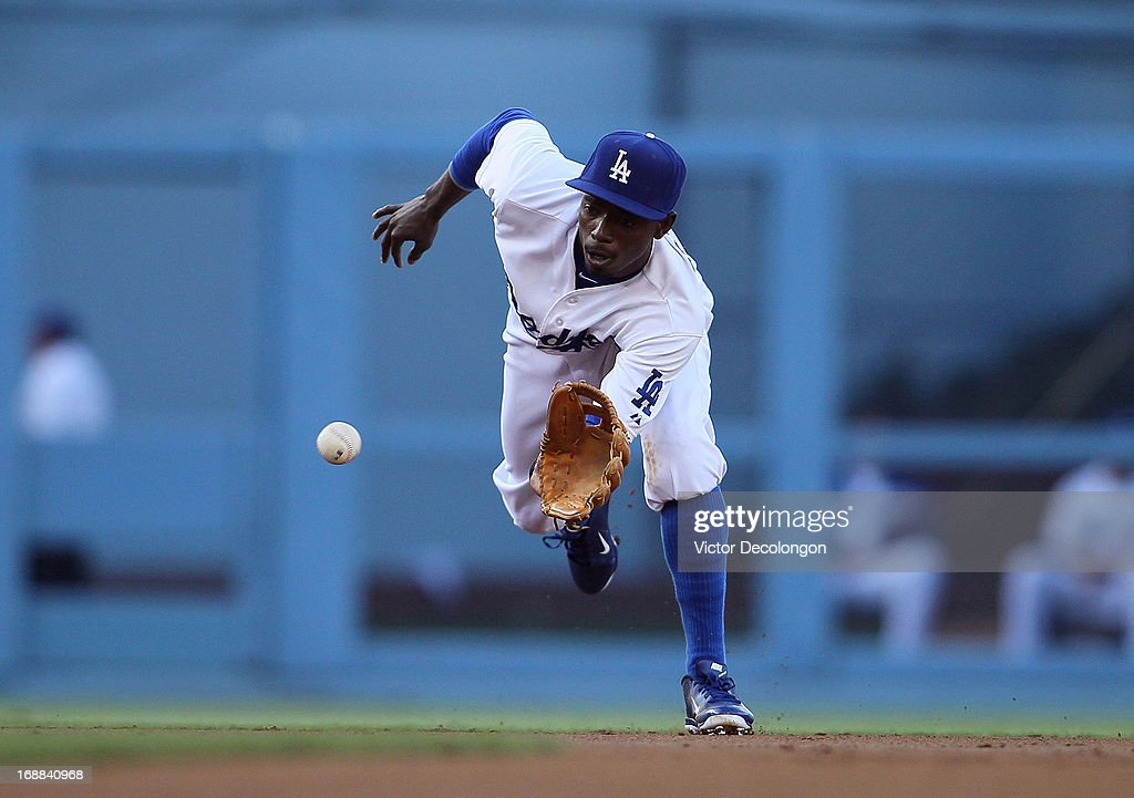 Dee Gordon #9 of the Los Angeles Dodgers fields a ground ball in the second inning during the MLB game against the Miami Marlins at Dodger Stadium on May 11, 2013 in Los Angeles, California. The Dodgers defeated the Marlins 7-1.