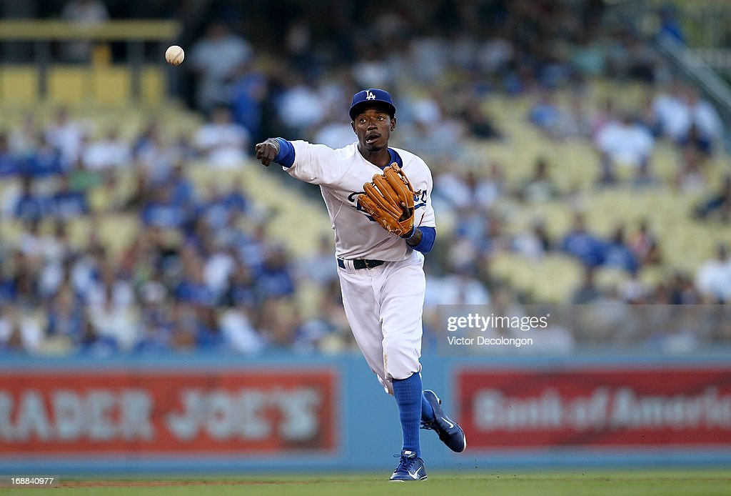 Dee Gordon #9 of the Los Angeles Dodgers fields a throw to first base during the MLB game against the Miami Marlins at Dodger Stadium on May 11, 2013 in Los Angeles, California. The Dodgers defeated the Marlins 7-1.