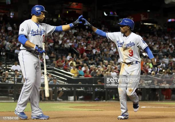 Dee Gordon of the Los Angeles Dodgers highfives James Loney after scoring a first inning run against the Arizona Diamondbacks during the Major League...