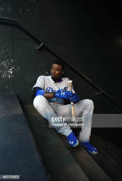 Dee Gordon of the Los Angeles Dodgers sits on the dugout steps and looks on prior to the start of the game against the San Francisco Giants at AT&T...