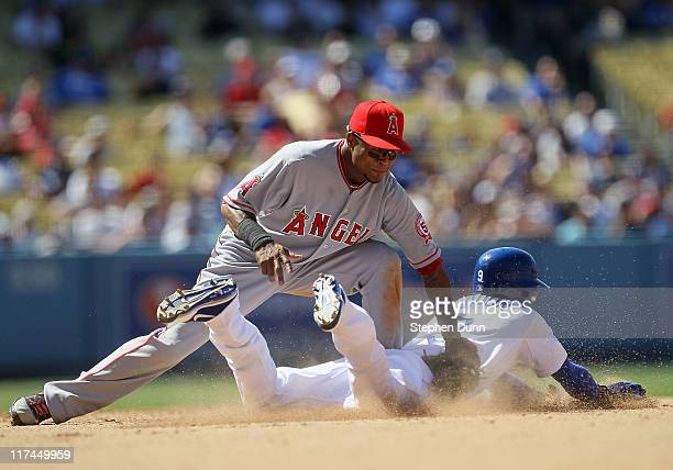 Dee Gordon of the Los Angeles Dodgers slides into second with a stolen base ahead of the tag by shortstop Erick Aybar of the Los Angeles Angels of...