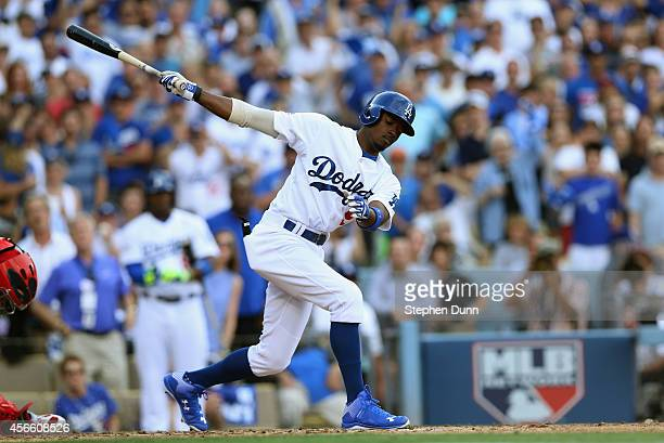 Dee Gordon of the Los Angeles Dodgers strikes out in the second inning during Game One of the National League Division Series against the St Louis...
