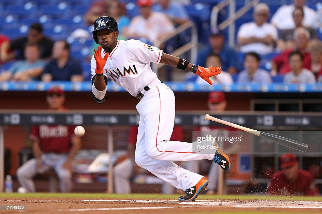 Dee Gordon #9 of the Miami Marlins bunts during the first inning of the game against the Arizona Diamondbacks at Marlins Park on May 20, 2015 in Miami, Florida.