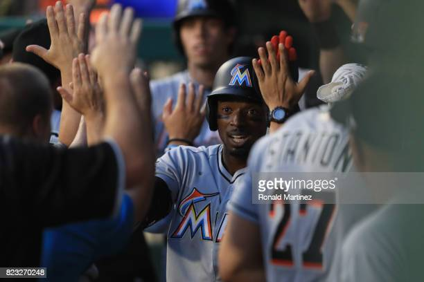 Dee Gordon of the Miami Marlins celebrates after scoring in the fourth inning against the Texas Rangers at Globe Life Park in Arlington on July 26...
