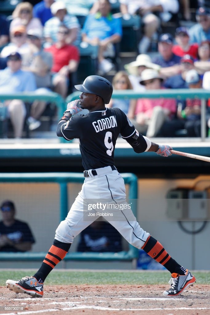 Dee Gordon #9 of the Miami Marlins hits a ground rule double to lead off the fifth inning of a Grapefruit League spring training game against the Atlanta Braves at Champion Stadium on March 20, 2017 in Lake Buena Vista, Florida. The Marlins defeated the Braves 9-3.