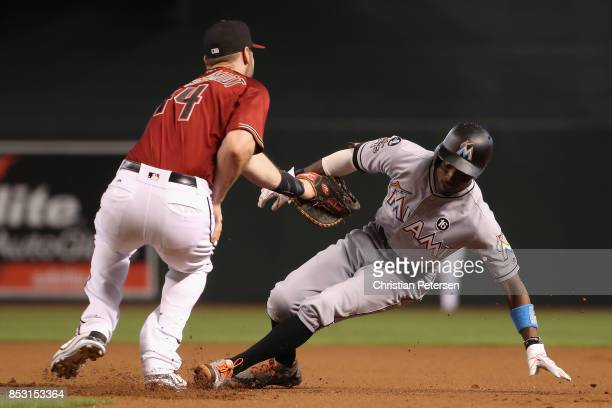 Dee Gordon of the Miami Marlins is tagged out in a run down by infielder Paul Goldschmidt of the Arizona Diamondbacks during the MLB game at Chase...