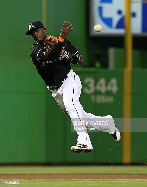 Dee Gordon of the Miami Marlins makes a throw to first during a game against the Tampa Bay Rays at Marlins Park on April 11 2015 in Miami Florida
