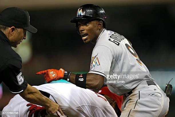Dee Gordon of the Miami Marlins pleads his case that he was safe at third base in the ninth inning against the Washington Nationals at Nationals Park...