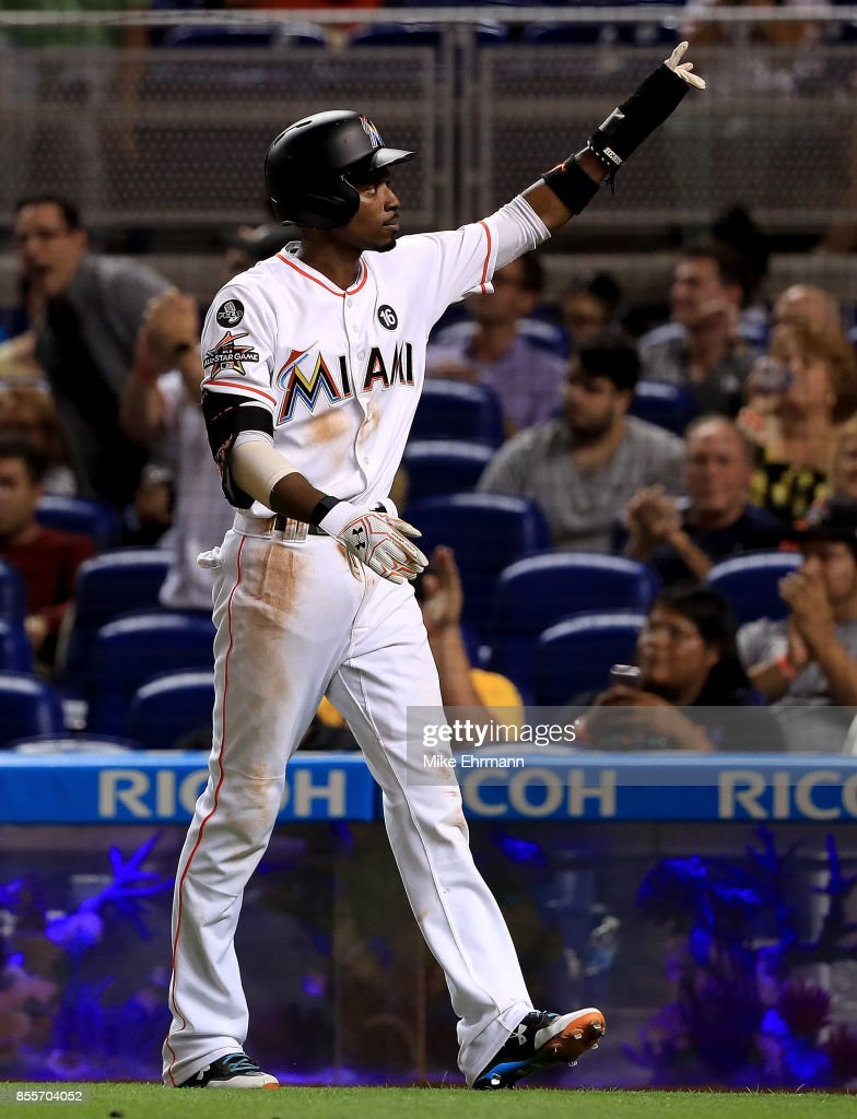 Dee Gordon #9 of the Miami Marlins reacts after scoring during a game against the Atlanta Braves at Marlins Park on September 29, 2017 in Miami, Florida.