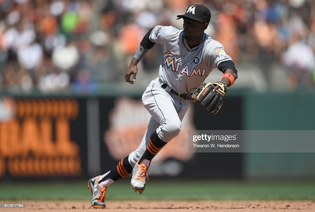 Dee Gordon #9 of the Miami Marlins reacts to his left to field a ground ball off the bat of Brandon Crawford #35 of the San Francisco Giants in the bottom of the six inning at AT&T Park on July 9, 2017 in San Francisco, California.