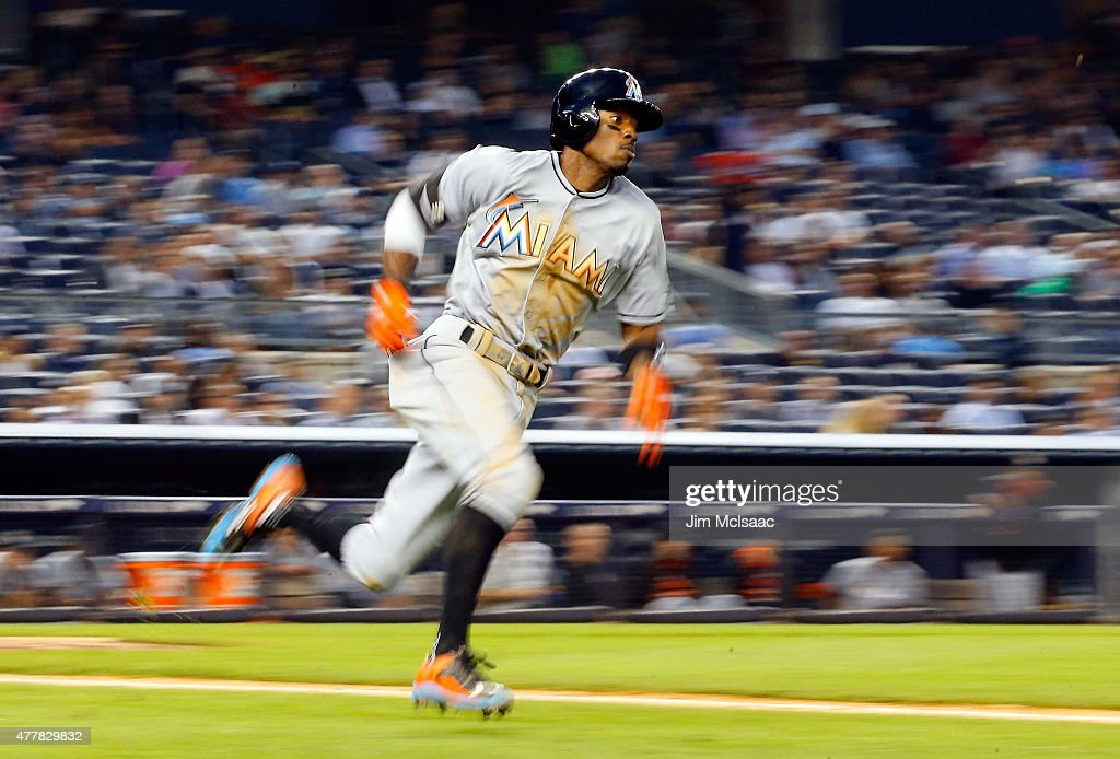 Dee Gordon #9 of the Miami Marlins runs out a fourth inning triple against the New York Yankees at Yankee Stadium on June 18, 2015 in the Bronx borough of New York City.