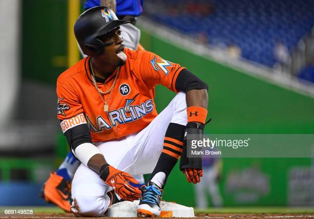 Dee Gordon of the Miami Marlins safe at third base on a throwing error in the first inning during the game between the Miami Marlins and the New York...
