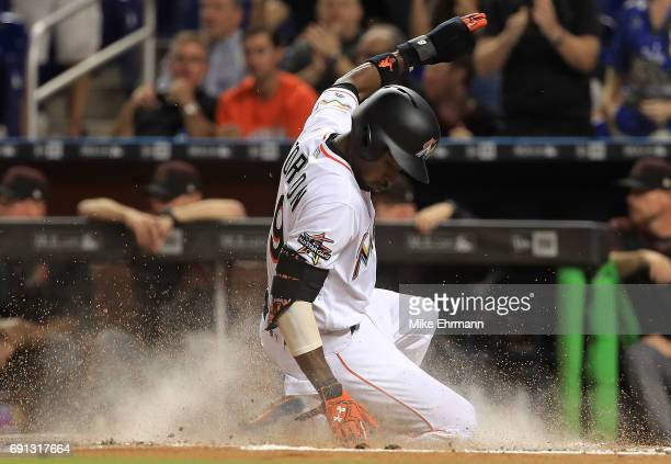 Dee Gordon of the Miami Marlins scores on a two RBI hit by Giancarlo Stanton during a game against the Arizona Diamondbacks at Marlins Park on June...