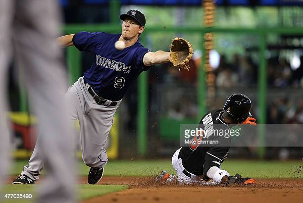 Dee Gordon of the Miami Marlins steals second as DJ LeMahieu of the Colorado Rockies fields the throw during a game at Marlins Park on June 13 2015...