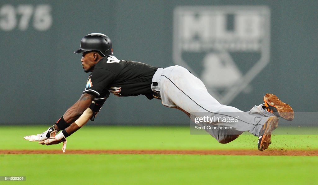 Dee Gordon #9 of the Miami Marlins steals second base during the ninth inning against the Atlanta Braves at SunTrust Park on September 8, 2017 in Atlanta, Georgia.