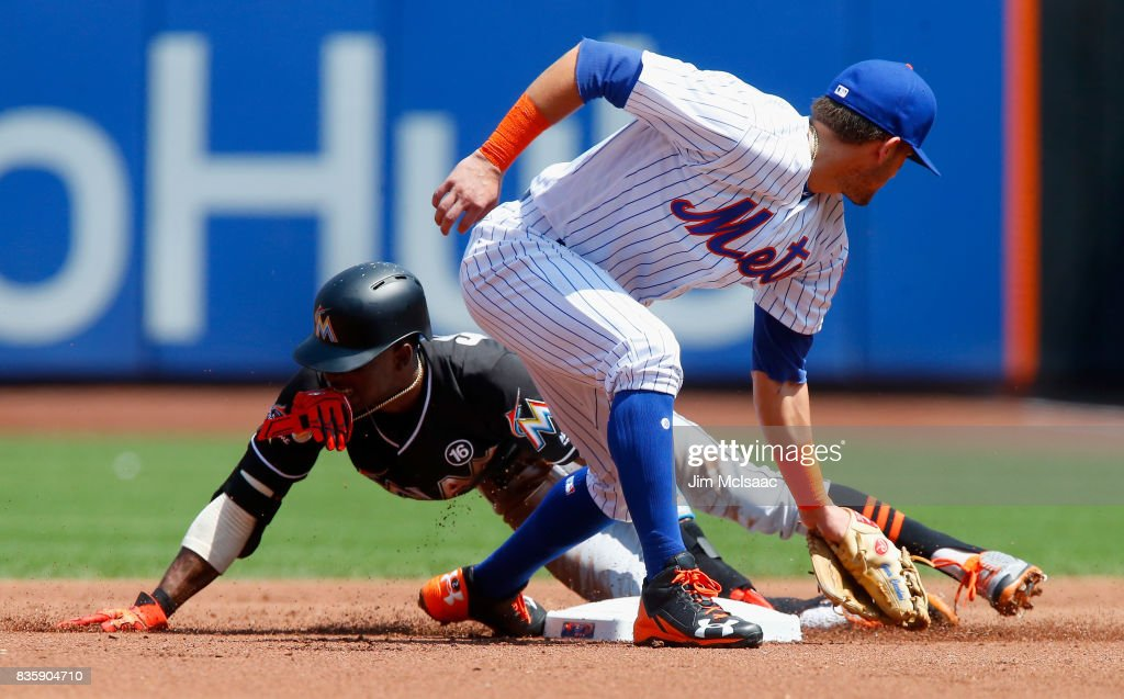 Dee Gordon #9 of the Miami Marlins steals second base in the first inning ahead of the tag from Gavin Cecchini #2 of the New York Mets at Citi Field on August 20, 2017 in the Flushing neighborhood of the Queens borough of New York City.