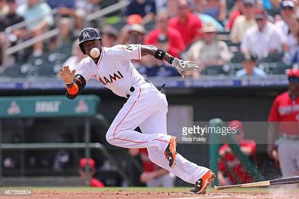 Dee Gordon of the Miami Marlins watches a bunted ball during the first inning of the game against the Minnesota Twins at Roger Dean Stadium on March...
