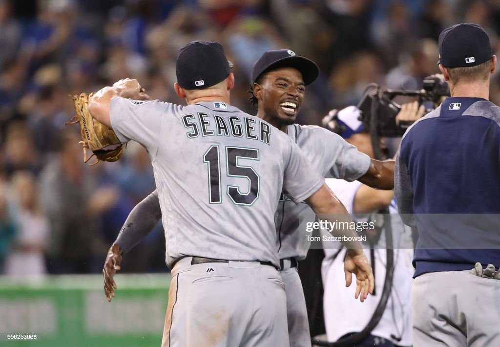 Dee Gordon #9 of the Seattle Mariners celebrates with Kyle Seager #15 after James Paxton #65 threw a no-hitter during MLB game action against the Toronto Blue Jays at Rogers Centre on May 8, 2018 in Toronto, Canada.
