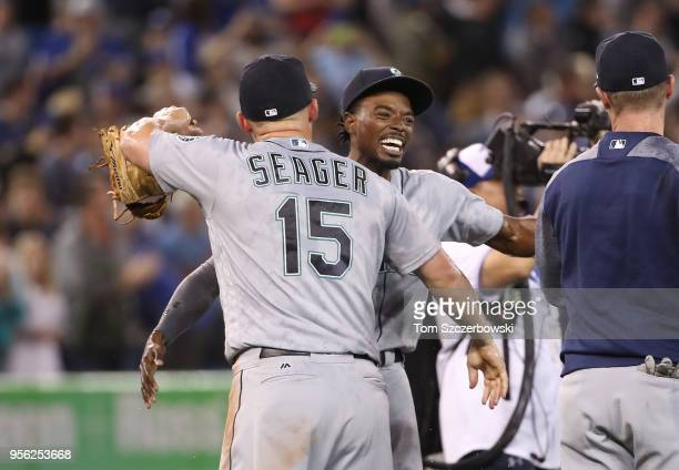 Dee Gordon of the Seattle Mariners celebrates with Kyle Seager after James Paxton threw a nohitter during MLB game action against the Toronto Blue...