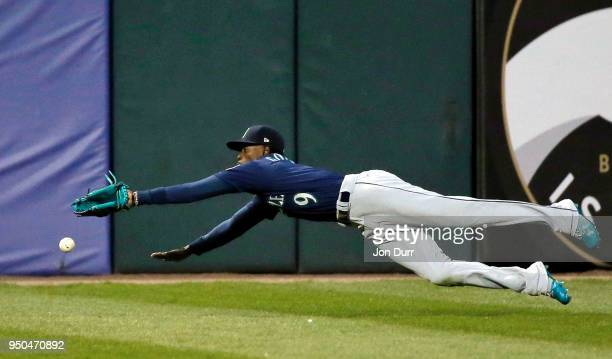 Dee Gordon of the Seattle Mariners dives and is unable to make a catch against the Chicago White Sox during the first inning at Guaranteed Rate Field...