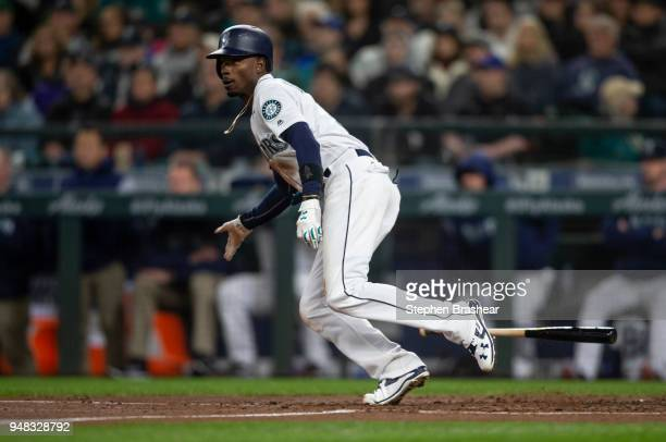 Dee Gordon of the Seattle Mariners gets a hit during an atbat in a game against the Oakland Athletics at Safeco Field on April 14 2018 in Seattle...