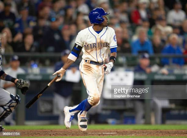 Dee Gordon of the Seattle Mariners hits a RBI-single off of relief pitcher Jose Alvarado of the Tampa Bay Rays that scored Guillermo Heredia of the...