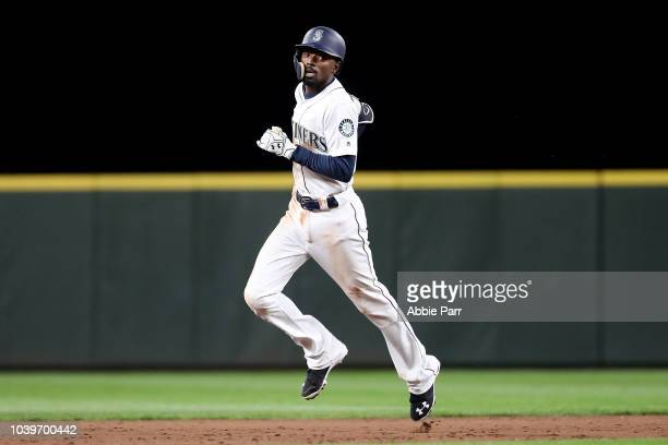 Dee Gordon of the Seattle Mariners laps the bases after hitting a two run home run against the Oakland Athletics to the tie game 3-3 in the sixth...