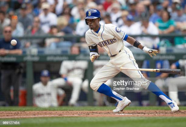 Dee Gordon of the Seattle Mariners lays down a bunt during the sixth inning a game at Safeco Field on July 1, 2018 in Seattle, Washington. The...
