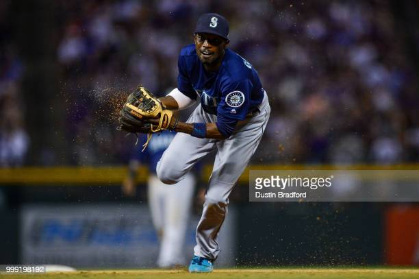 Dee Gordon of the Seattle Mariners moves to throw to first base for an out after fielding a ground ball against the Colorado Rockies at Coors Field...