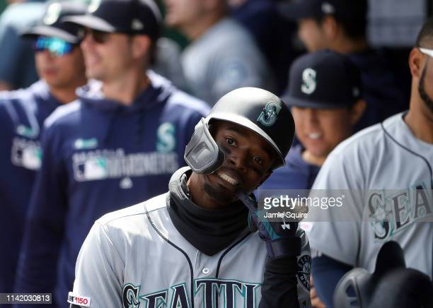 Dee Gordon of the Seattle Mariners reacts in the dugout after hitting a home run during the game against the Kansas City Royals at Kauffman Stadium...
