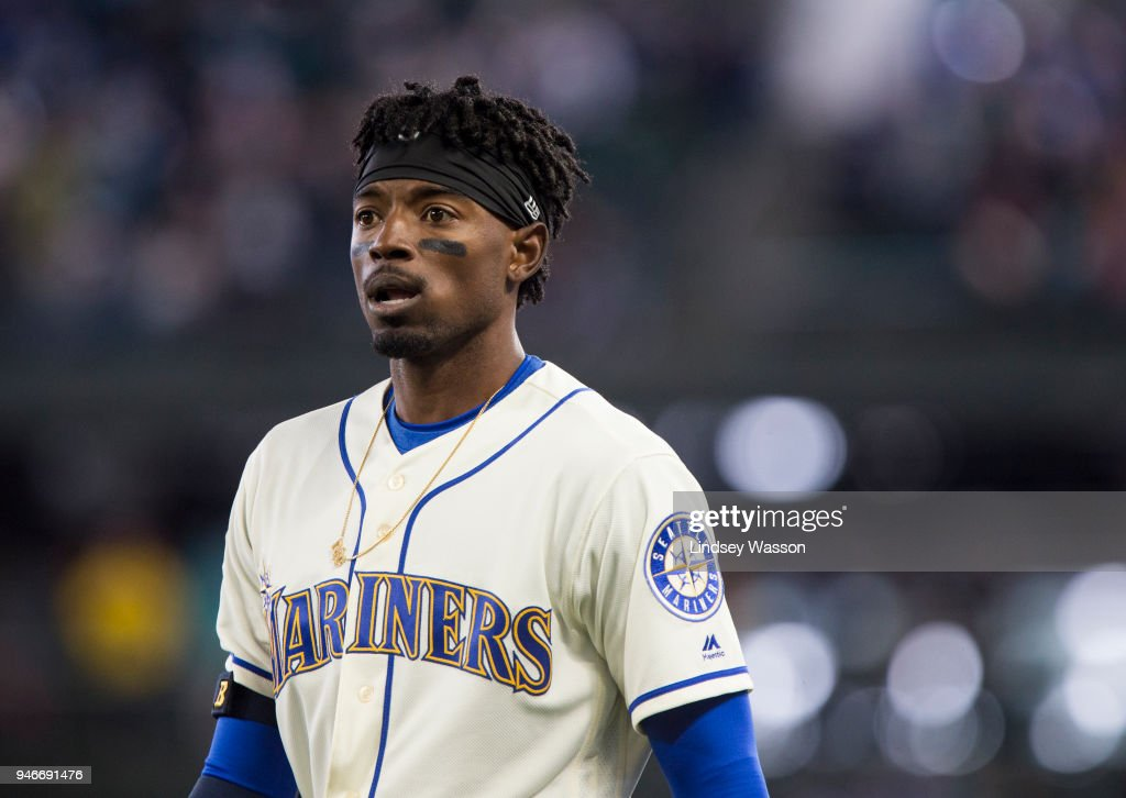 Dee Gordon #9 of the Seattle Mariners reacts to being called out at first on a bunt, which was reviewed and upheld, during the ninth inning against the Oakland Athletics at Safeco Field on April 15, 2018 in Seattle, Washington. All players are wearing #42 in honor of Jackie Robinson Day.