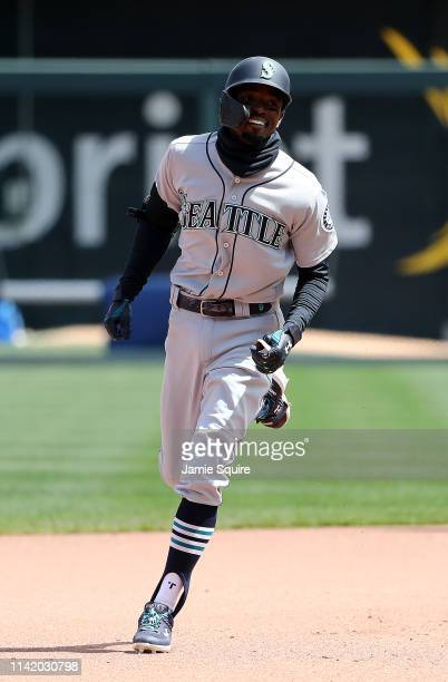 Dee Gordon of the Seattle Mariners rounds the bases after hitting a home run during the game against the Kansas City Royals at Kauffman Stadium on...