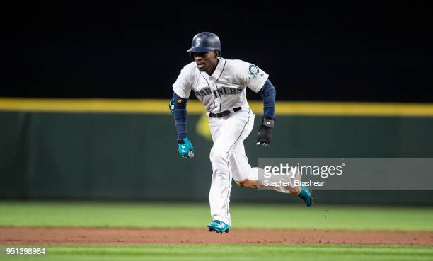 Dee Gordon of the Seattle Mariners runs from second base to third base during a game against the Houston Astros at Safeco Field on April 18 2018 in...
