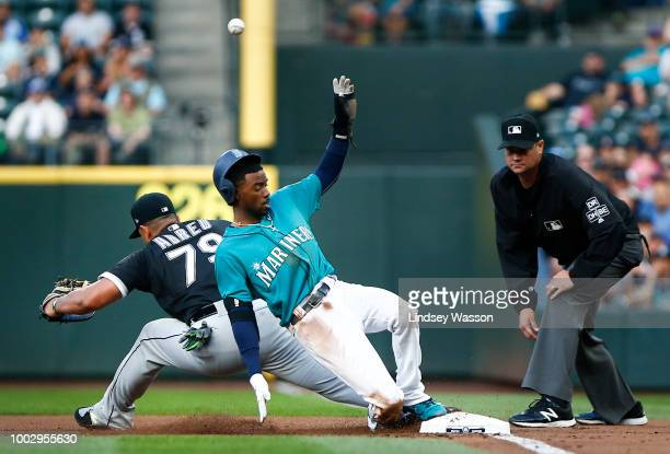 Dee Gordon of the Seattle Mariners safely tags first and eventually makes it to second as Jose Abreu of the Chicago White Sox can't get to a high...