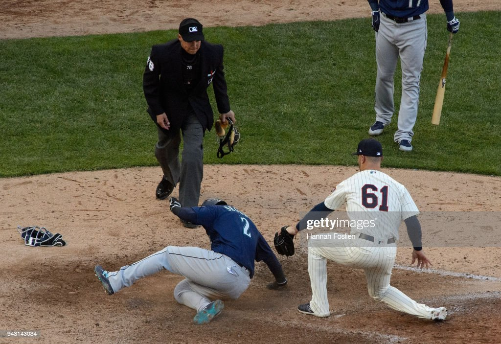 Dee Gordon #9 of the Seattle Mariners slides safely into home plate against pitcher Tyler Kinley #61 of the Minnesota Twins to score following a wild pitch during the ninth inning of the game on April 7, 2018 at Target Field in Minneapolis, Minnesota. The Mariners defeated the Twins 11-4.