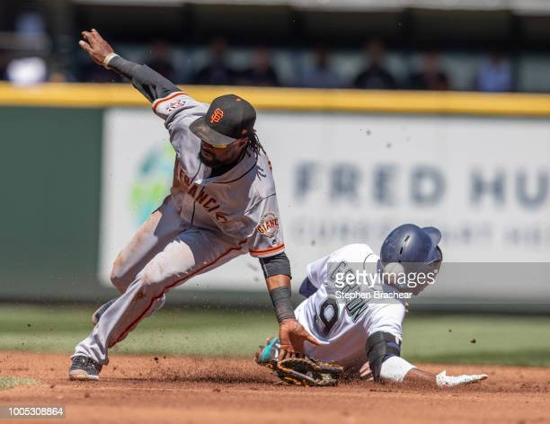 Dee Gordon of the Seattle Mariners steals second base as second baseman Alen Hanson of the San Francisco Giants cannot hold on to a throw by catcher...