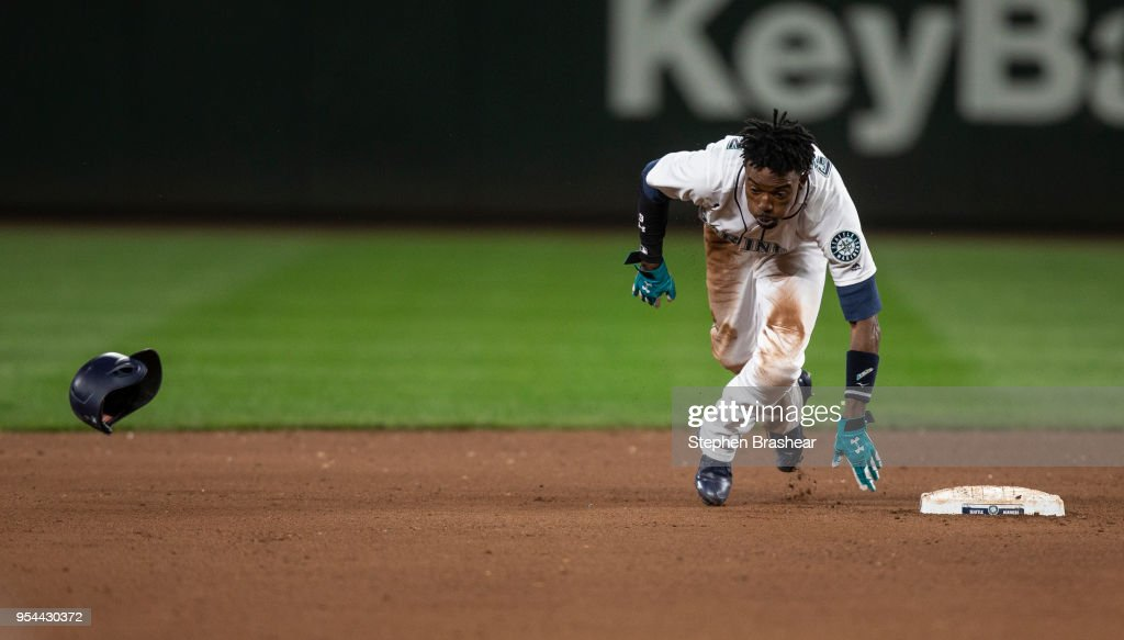 Dee Gordon #9 of the Seattle Mariners takes off for third base after stealing second base during the seventh inning of a game against the Oakland Athletics at Safeco Field on May 3, 2018 in Seattle, Washington. The Mariners won the game 4-1.