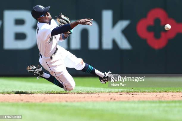 Dee Gordon of the Seattle Mariners throws out Tyler Wade of the New York Yankees at first in the second inning during their game at TMobile Park on...