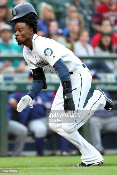Dee Gordon runs home to score on a sacrifice fly by Jean Segura of the Seattle Mariners in the first inning against the Texas Rangers during their...