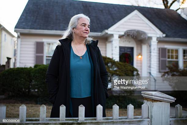 Dee Harris is pictured in the front yard of her Cape Cod at the corner of West Avenue and Ridge Street across the street from the rear of a retail...