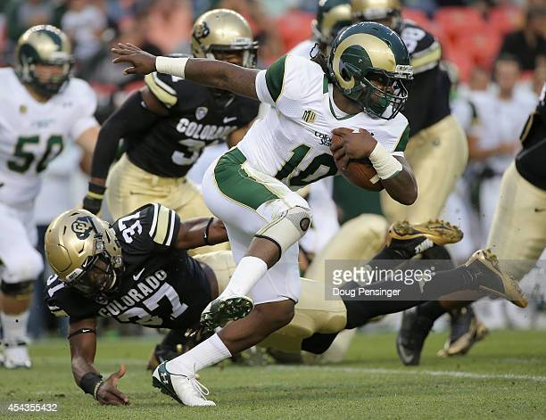 Dee Hart of the Colorado State Rams breaks a tackle by Woodson Greer III of the Colorado Buffaloes to pick up yardage in the Rocky Mountain Showdown...