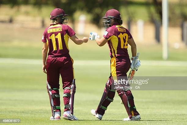 Dee Kimmince of the Fire greets Ash Barty as she comes out to bat during the WNCL match between South Australia and Queensland at Railsways Oval on...