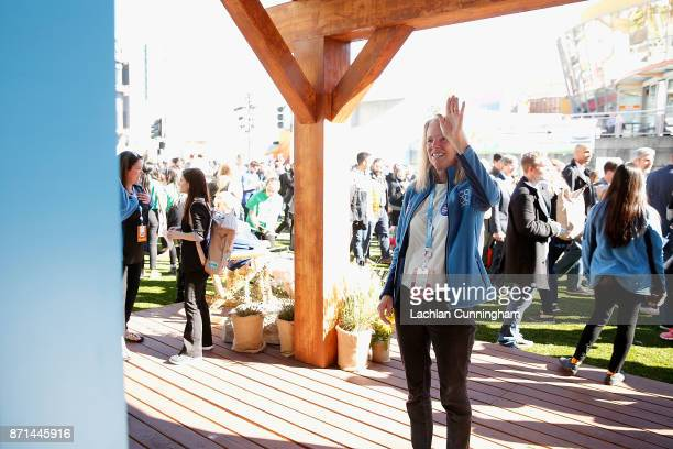 Dee Lawrence founder of nonprofit Cool Effect engages with the Carbon Vision Mirror at Dreamforce on November 7 2017 in San Francisco California...