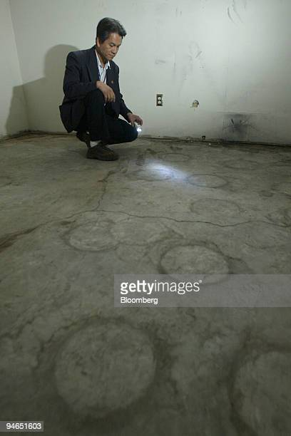 Dee Nguyen realtor is pictured inside this home in the suburb of Sundance in Calgary Alberta Canada Wednesday April 26 2006 Circles on the basement...