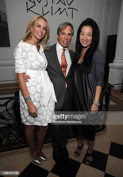 Dee Ocleppo and designer Tommy Hilfiger pose with designer Vera Wang at their engagement party hosted by Leonard and Evelyn Lauder at Neue Galerie on...