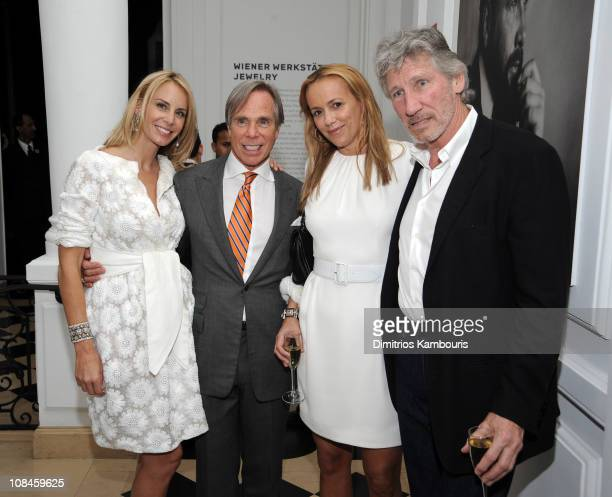 Dee Ocleppo and designer Tommy Hilfiger pose with Laurie Durning and musician Roger Waters at their engagement party hosted by Leonard and Evelyn...