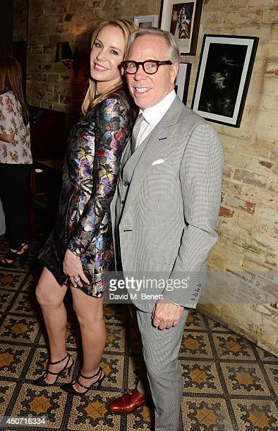 Dee Ocleppo and Tommy Hilfiger attend a private dinner hosted by Jonathan Newhouse and Tommy Hilfiger to celebrate London Collections Men SS15 at...