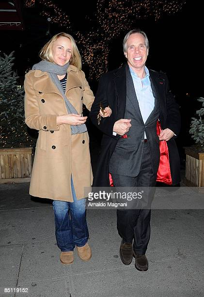 Susie Hilfiger and designer Tommy Hilfiger leave a restaurant on Madison Ave on February 25 2009 in New York City